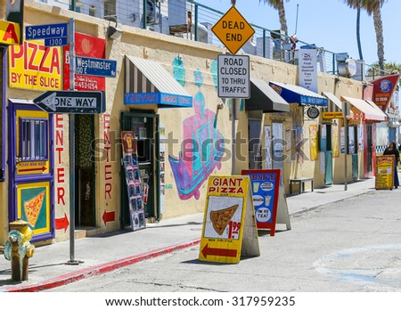VENICE BEACH, USA - JUNE 4, 2014: Several colorful snack shacks in a row offering different kinds of food at the ocean front. - stock photo