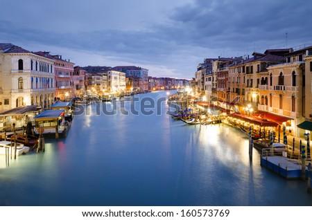 Venice. Beautiful Grand Canal view illuminated at dusk from Rialto Bridge, Venezia, Italy - stock photo