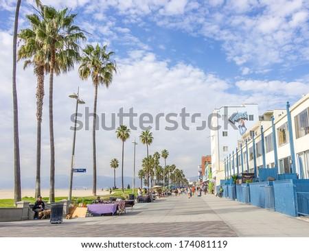 VENICE,CA - DECEMBER 18, 2013: Ocean Front Walk of Venice Beach in Venice, US. This boardwalk is 2.5 kilometer long - stock photo