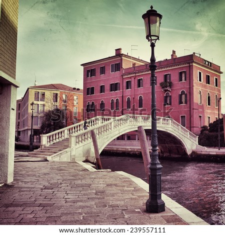 Venice canal and bridge. Tourists from all the world enjoy the historical city of Venezia in Italy, famous UNESCO World Heritage Site. Filtered image, vintage effect applied - stock photo