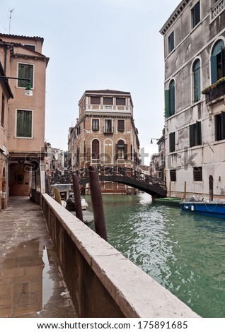 Venice Castello block of houses and Ponte Dei Conzafelzi in winter day - stock photo