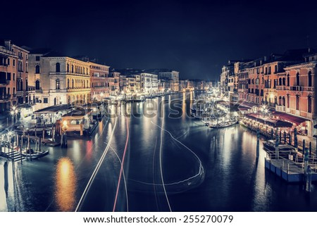 Venice city at night, beautiful majestic cityscape, many glowing lights in the buildings over grand canal at nighttime, tourism and travel to Italy - stock photo