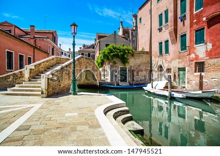 Venice cityscape, narrow water canal, bridge, boats, and traditional buildings. Italy, Europe. - stock photo