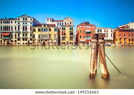 Venice cityscape, water grand canal and traditional buildings facade. Italy, Europe. Long exposure photography. - stock photo