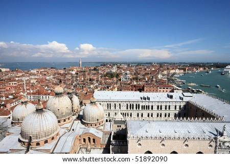 Venice cityscape with Basilica San Marco - famous old city in Italy. Mediterranean Sea in background.