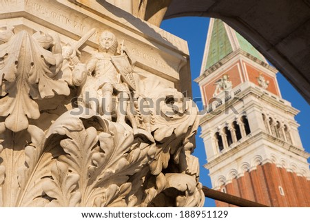 Venice - Detail from capital of Doge palace and bell tower in background  - stock photo
