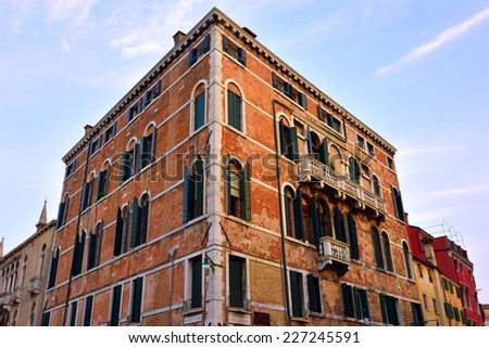Venice facade at sunset Tourists from all the world enjoy the historical city of Venezia in Italy, famous UNESCO World Heritage Site - stock photo