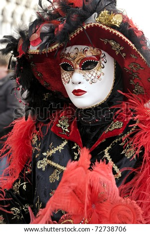 VENICE - FEBRUARY 28: An unidentified person in costume in St. Mark's Square during the Carnival of Venice on February 28, 2011.  The annual carnival was held in 2011 from February 26th to March 8th.