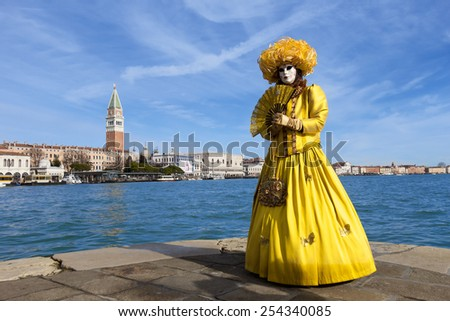 VENICE - FEBRUARY 7: Costumed woman with the Plz San Marco in the back during Venice Carnival on February 7, 2013 in Venice, Italy. This year the Carnival was held between January 26 - February 12. - stock photo
