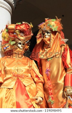 VENICE - FEBRUARY 26: Masked performers greet visitors at the 2011 Venice Carnival celebration event at Saint Mark Square on February 26, 2011 in Venice, Italy.