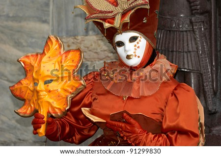 VENICE - FEBRUARY 15, 2007: Person in costume attends the Carnival of Venice, festival starting two weeks before Ash Wednesday and ends on Shrove Tuesday, on February 15, 2007 in Venice, Italy.