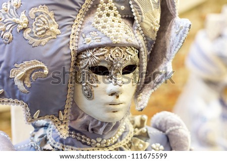 VENICE - FEBRUARY 21: Person in Venetian costume attends the Carnival of Venice, festival starting two weeks before Ash Wednesday, on February 21, 2011 in Venice, Italy.