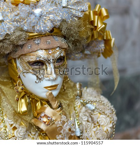 VENICE - FEBRUARY 21: Person in Venetian costume attends the Carnival of Venice, festival starting two weeks before Ash Wednesday on February 21, 2011 in Venice, Italy.
