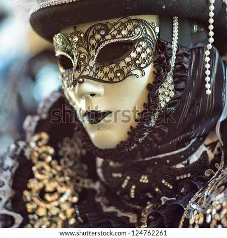 VENICE - FEBRUARY 17: Person in Venetian costume attends the Carnival of Venice, festival starting two weeks before Ash Wednesday on February 17, 2012 in Venice, Italy. - stock photo