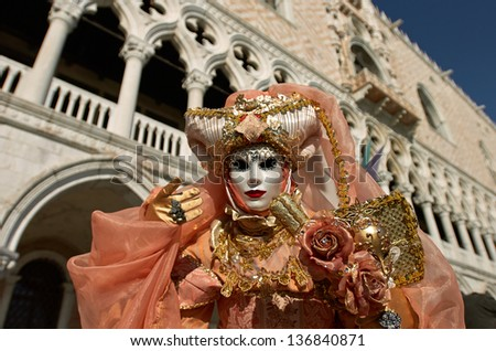 VENICE - FEBRUARY 8: Person in Venetian costume attends the Carnival of Venice, festival starting two weeks before Ash Wednesday on February 8, 2013 in Venice, Italy. - stock photo
