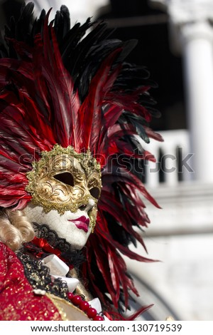 VENICE - FEBRUARY 10 - Undefined person wears traditional mask at the Carnival in Venice, Italy, on February 10, 2013. The last day of the Carnival of Venice on Piazza San Marco.
