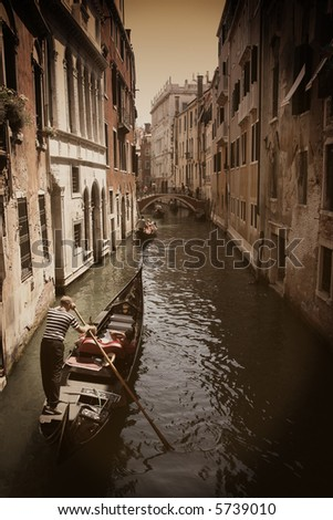 Venice Gondola on canal. Sepia toned with vignetting.
