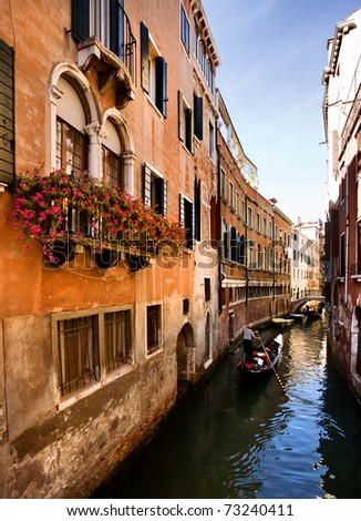 Venice, Gondola ride in a romantic small canal - stock photo