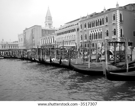 Venice gondolas and shoreline in black and white - stock photo