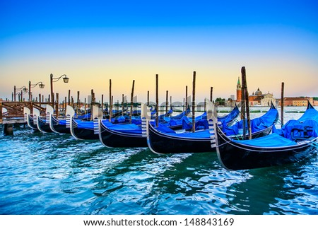 Venice, gondolas or gondole on a blue sunset twilight and San Giorgio Maggiore church landmark on background. Italy, Europe. - stock photo