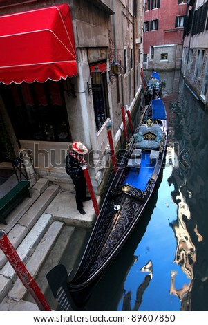 Venice, Gondolier waiting for customer in Italy - stock photo