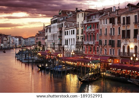 Venice Grand Canal gondolas, hotels and restaurants at sunset from the Rialto Bridge - stock photo
