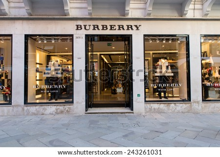 Venice, IT. November 14, 2014. The Burberry shop in Venice. Burberry Group plc is a British luxury fashion house, distributing outerwear, fashion accessories, fragrances, sunglasses, and cosmetics.  - stock photo