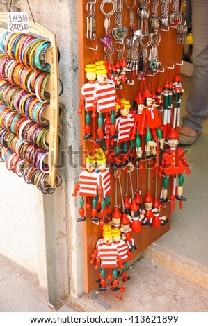 VENICE, ITALY - APRIL 22, 2016: Wooden pinocchio souvenirs for sale at the entrance of a gift shop - stock photo