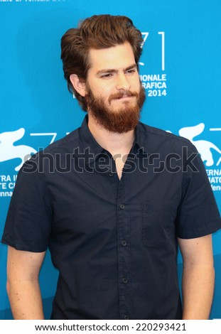 VENICE, ITALY - AUGUST 29: Andrew Garfield attend the '99 Homes' photocall during the 71st Venice Film Festival in August 29, 2014 in Venice, Italy  - stock photo