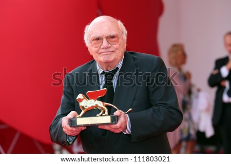 VENICE, ITALY - AUGUST 31:Francesco Rosi poses with his Golden Lion for Lifetime Achievement he received after an award ceremony at the Venice Film Festival on August 31, 2012 in Venice, Italy - stock photo