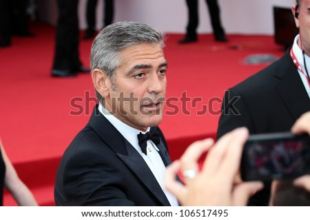 VENICE, ITALY - AUGUST 31: George Clooney during the ' Ides of March ' red carpet at the Palazzo Del Cinema during the 68th Venice Film Festival on August 31, 2011 in Venice, Italy. - stock photo