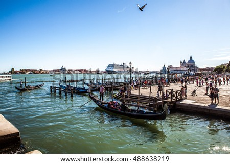 VENICE, ITALY - AUGUST 17, 2016: Traditional gondolas on narrow canal close-up on August 17, 2016 in Venice, Italy.