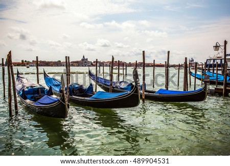 VENICE, ITALY - AUGUST 19, 2016: Traditional gondolas on narrow canal close-up on August 19, 2016 in Venice, Italy.