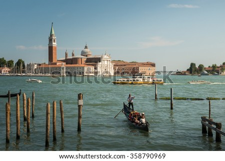Venice, Italy Beautiful view of famous romantic traditional Gondola on Canal Grande with San Giorgio Maggiore church in the background, San Marco under Clear Blue Sky Summer - stock photo