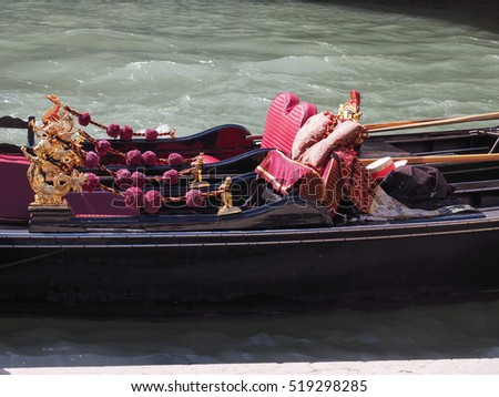 VENICE, ITALY - CIRCA SEPTEMBER 2016: Gondola traditional flat bottomed rowing boat in the Venetian lagoon