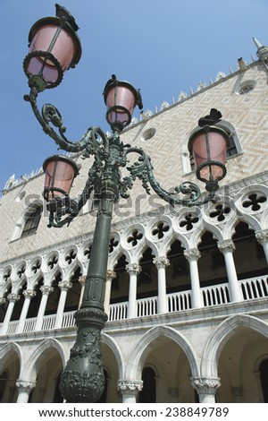 Venice Italy Doge's Palace architectural detail with lamppost in the Piazzetta di San Marco - stock photo