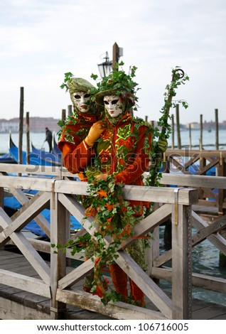 VENICE, ITALY - FEB 18: Unidentified persons in Venetian mask at St. Marco Square, Carnival of Venice on February 18, 2011. - stock photo