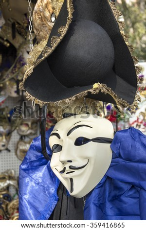 VENICE, ITALY - FEBRUARY 15, 2015: Anonymous venetian mask for sale in street market  during the Carnival of Venice, in Italy. - stock photo