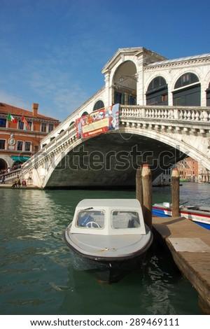 VENICE, ITALY - FEBRUARY 21: Boat at the Rialto bridge in Venice, in a beautiful sunny day. - Feb 21, 2014. Italy, Venice. - stock photo