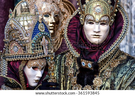 VENICE, ITALY- FEBRUARY 14, 2010: Couple dressed in Venetian Carnival  Costumes at Carnival of Venice, Italy. The Carnival in Venice is annual event which ends on Shrove Tuesday.