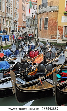 VENICE, ITALY-FEBRUARY 14, 2007: gondola for tourists at Cavalletto parking. Venice is a great tourists attraction with more than 27 million tourists every year. - stock photo