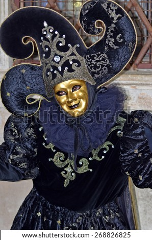 VENICE, ITALY - FEBRUARY 12: Jester in dark purple at the 2015 Venice Carnival:  February  12, 2015 in Venice, Italy