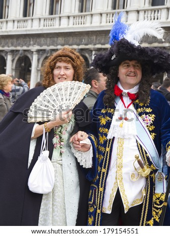 VENICE, ITALY - FEBRUARY 26, 2014 - Participants of the Venice Carnival pose to the audience during the famous Carnival of Venice.