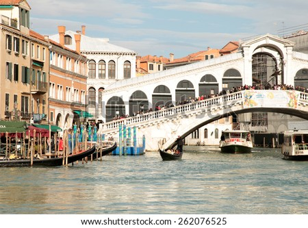 VENICE, ITALY - FEBRUARY 7 , 2015: Rialto bridge with tourists and boats on Grand Canal, Venice, Italy