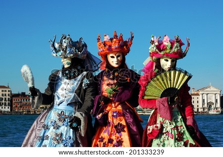 VENICE, ITALY - FEBRUARY 24: The carnival of Venice is held in Italy. Group of people in colorful costumes and masks, view on the Grand Canal. Wonder and Fantasy Nature. Venice, Italy - Feb 24, 2014 - stock photo