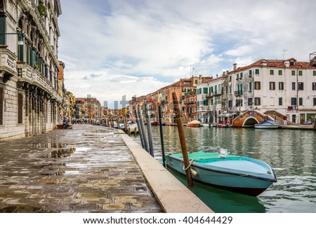 Venice, Italy - 10 February 2016: The Streets of Venice with people engaging in daily activity.