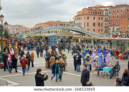 VENICE, ITALY-FEBRUARY 10, 2007: Tourists at the train station square in a carnival day. Venice is a great tourists attraction with more than 27 million tourists every year. - stock photo