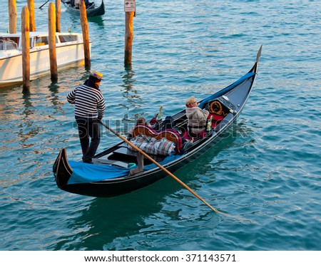 Venice, Italy - February 01, 2015: Tourists visit Venezia with a Gondola. Gondola ride is one of the most popular tourist attractions in Venice. - stock photo