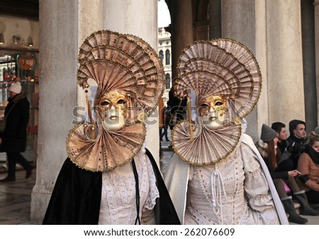 VENICE, ITALY - FEBRUARY 7, 2015: Two unidentified masked persons in costume on San Marco Square during the Carnival in Venice, Italy. - stock photo