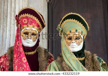 VENICE, ITALY - FEBRUARY 16, 2015: Two venetian masks posing at Venice carnival - stock photo